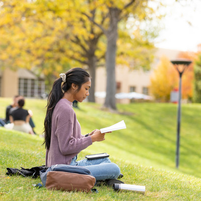 female-student-sitting-on-grass.jpg